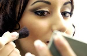 Makeup, hispanic woman applying makeup
