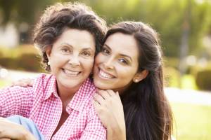 hispanic mother and daughter, hispanic women, young woman and older woman