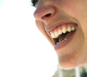 WOMAN smiling, closeup of woman