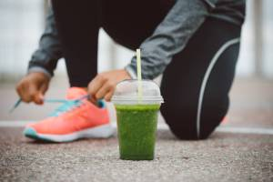 woman running, woman running and drinking smoothie, green smoothie, green drink