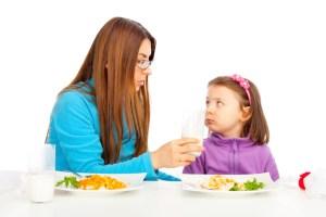 mother feeding daughter