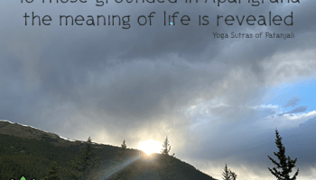 sun peeking over mountains= ridge, cloudy sky over mountains - Aparigraha Quote: To those grounded in Aparigraha (non-attachment) the meaning of life is revealed. - Yoga Sutras of Patanjali