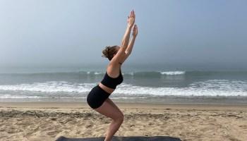 Utkatasana - powerful chair pose - yoga pose girl sunny day yoga on the beach