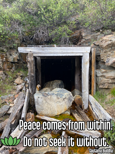 collapsed mine portal abandoned mining ruin with large boulder and green shrubbery - santosha contentment happiness appreciation gratitude Quote: Peace comes from within. Do not seek it without. - Gautama Buddha