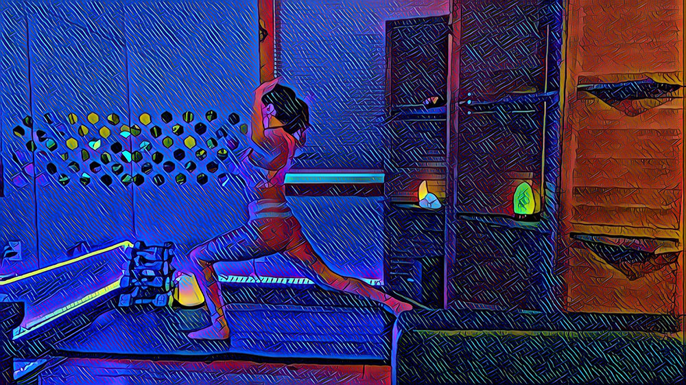 Ashta Chandrasana - high lunge pose with cactus arms - yoga pose yoga girl wearing purple doing yoga inside in purple yoga studio with artsy effect