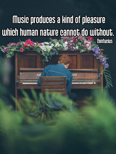 cool shot of redheaded man in denim shirt playing piano covered in multicolored bouquet of flowers on dark background - mindful mindfulness music Quote: Music produces a kind of pleasure which human nature cannot do without. - Confucius original work - https://unsplash.com/photos/nj0vGyFB2nY