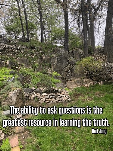 cool new england rock garden landscape with bright green grass, gray rocks, and trees under partly cloudy sky - satya truth truthfulness self honesty Quote: The ability to ask questions is the greatest resource in learning the truth. - Carl Jung