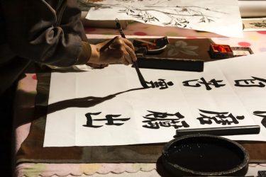 Person creating calligraphy original work - https://unsplash.com/photos/zHwWnUDMizo