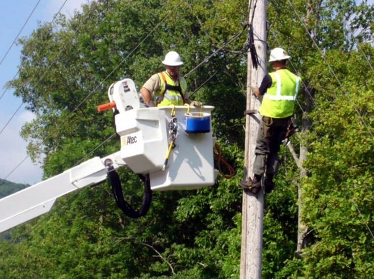 Linemen for the North Georgia Network Cooperative work on telephone lines.