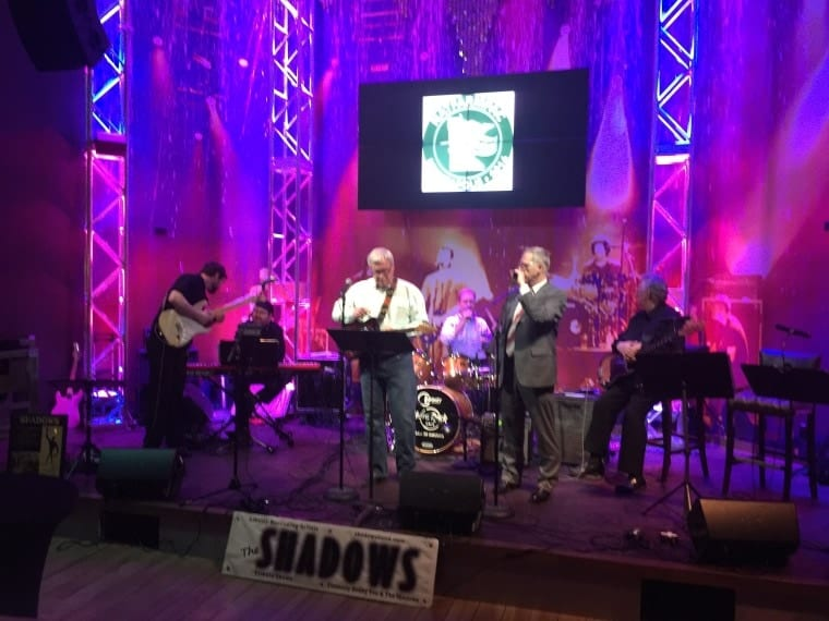 Minnesota Congressman Collin Peterson (right) rocks out with the band at a reception sponsored by the Nat Farm Pac during the week of the NFU convention.