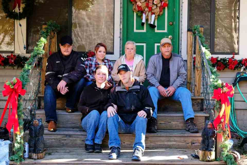 Victoria McCaa, front left, with her husband, Richard, and family in front of her parents-in-law's home, which was spared in the fires, just south of downtown Gatlinburg, Tennessee. Photo by Shawn Poynter