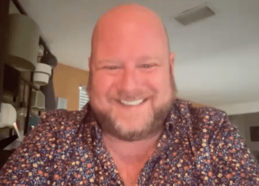 A man smiles on his webcam during a Zoom call