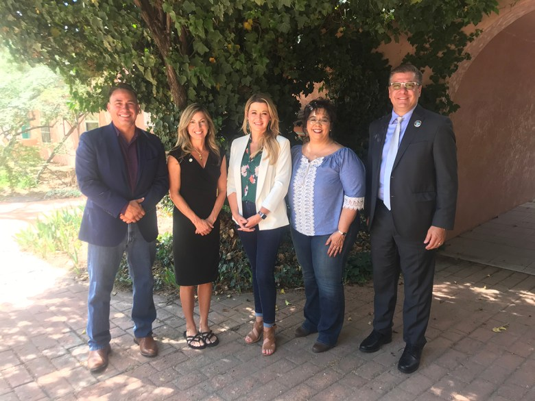 Photo of New Mexico state legislators standing together outdoors