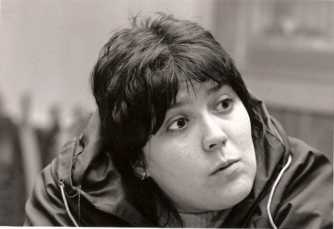 A black and white photo of Siân James' face, looking to the right of the frame.