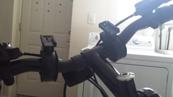 speaker attached with brackets to  bike