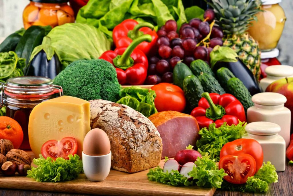 125   Variety of organic food including vegetables fruit bread dairy and meat. Balanced diet.