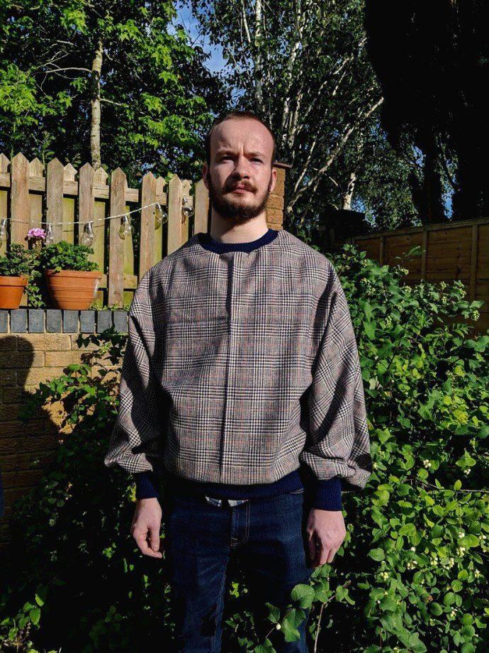 Daines Atelier Customer wearing a batwing jumper