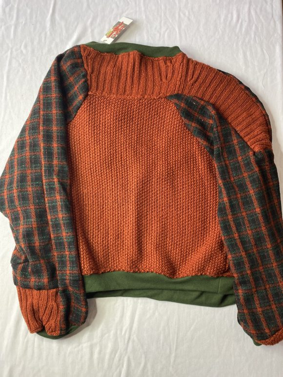Back flat lay of upcycled acrylic jumper and tartan featuring zero waste panelling