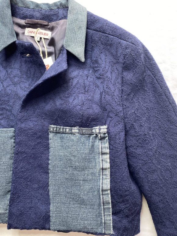 Cropped upcycled vintage jacket in floral with denim collar and long denim pockets with Daines atelier logo branding.