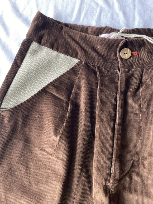Brown corduroy high waisted trousers with wool pocket, wooden button and right red button hole