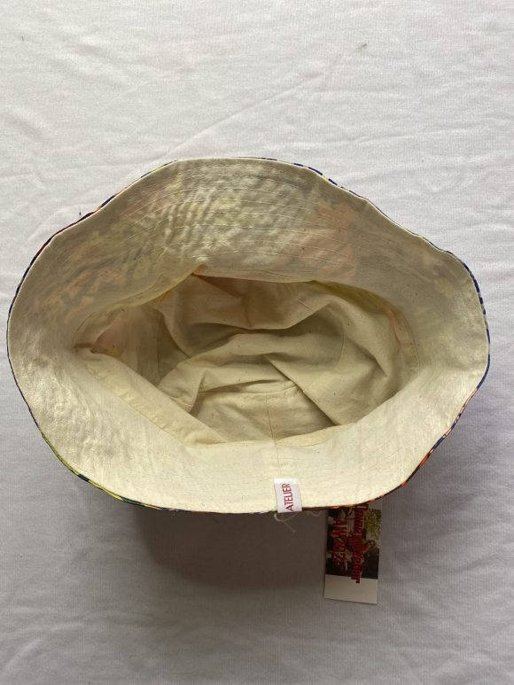 Inside material calico of reversible bucket hats with Daines atelier branding and top stitching