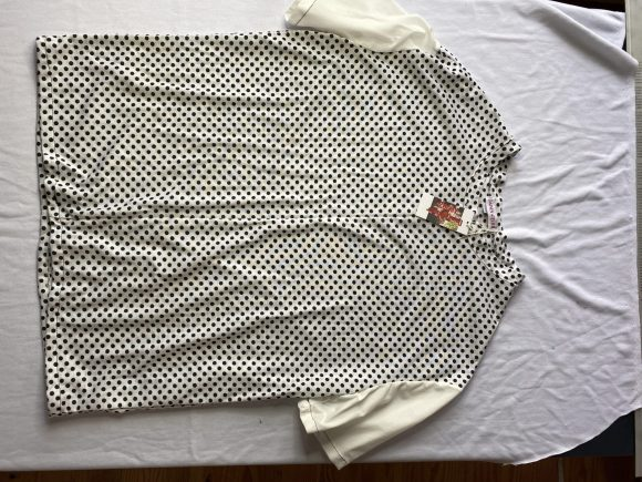 Front flat of polka dot tee made from feedstock vintage jersey and mid match sleeves. Featuring Daines atelier swing tag and label
