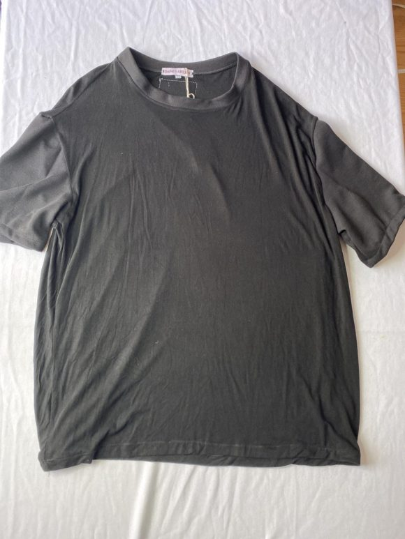 Flat lay front of oversized black tee made with remnant vintage material