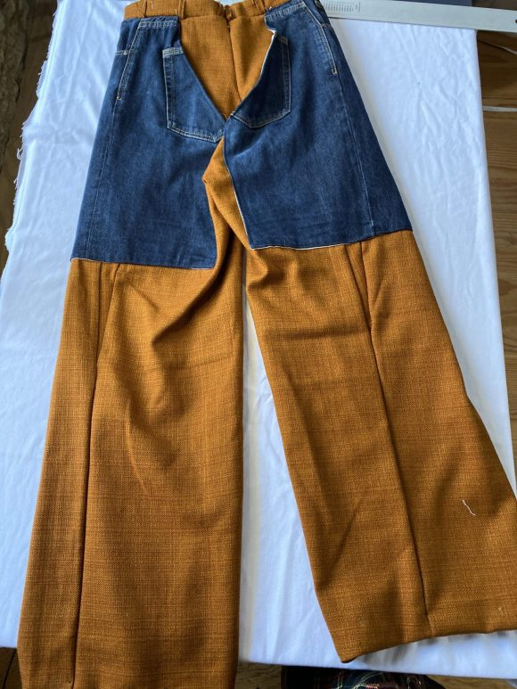 Back Flatlay of Trouser chaps with denim and orange wool, straight leg trouser sustainable and ethical one of a kind