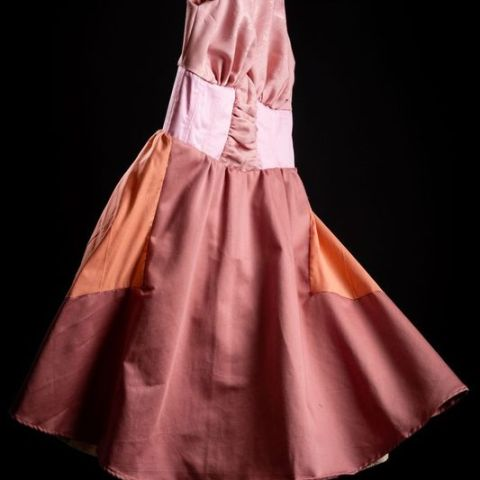 Pink floating dress in silk and cotton floating with full circle skirt. 50S style day dress. Photography by Yousef Al Nasser