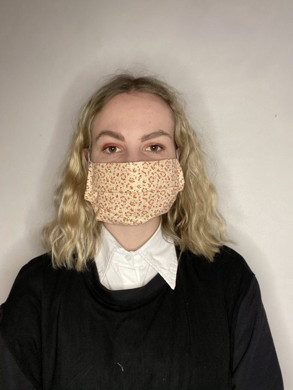 Handmade breathable facemask with filter pocket and adjustable elastic made from vintage remnant materials In Laura Ashley Orange Floral