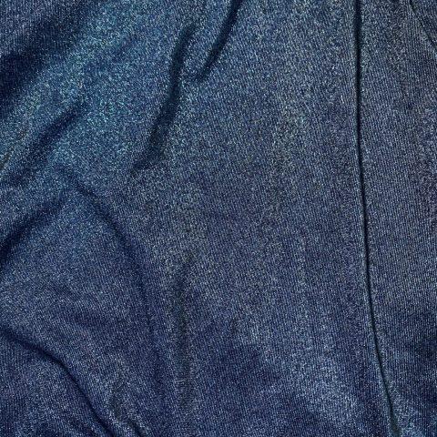 Blue glittery turtleneck made from deadstock vintage jersey.