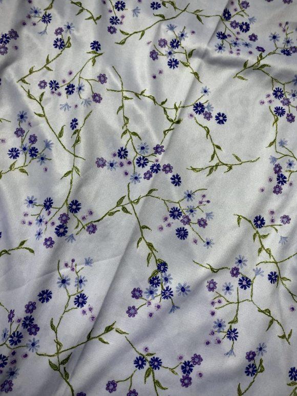Purple and blue floral oversized turtleneck in deadstock vintage jersey.