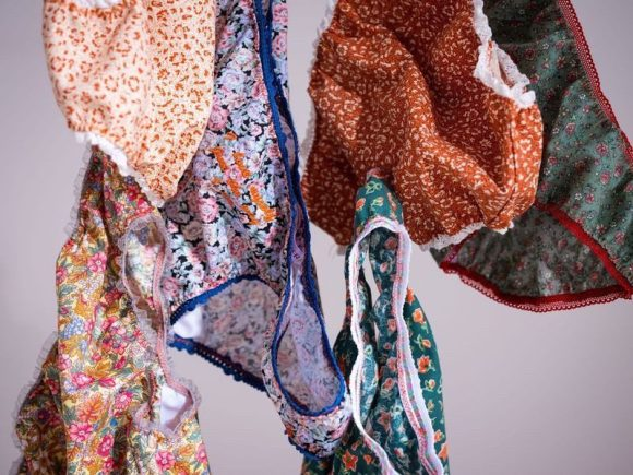 Photograph by Yousef Al Nasser of Body Positivity Panties floating in different vintage floral remnants and vintage knicker elastic