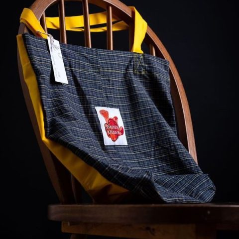 Tote bag in tartan and yellow with Daines atelier branding made from deadstock materials