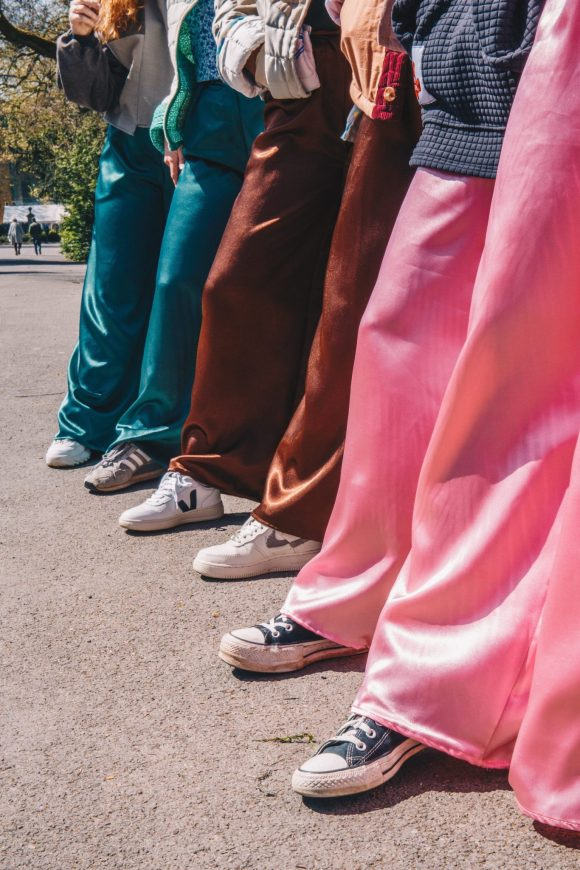 The mimosa trousers are made from dead stock satin backed crepe from Amorthreads. The trousers are wide leg and feature an elasticated waistband. Photograph by Maisie Lee Walker