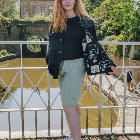 Grace Daines wears the black quilted Jacket made from vintage remnants and dead stock corduroy. Grace also wears the mint green boxing shorts. Photography by Maisie Lee walker in Bath Sydney Gardens