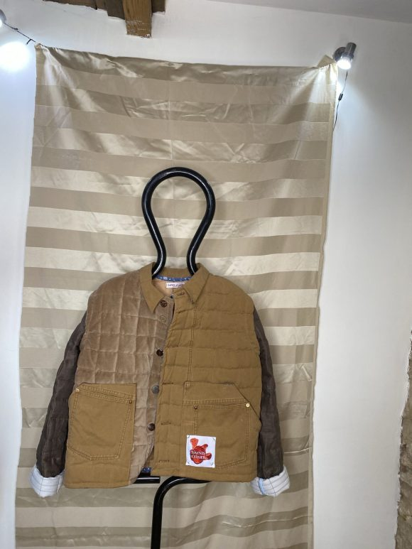Front of the quilted brown jacket made from upcycled materials