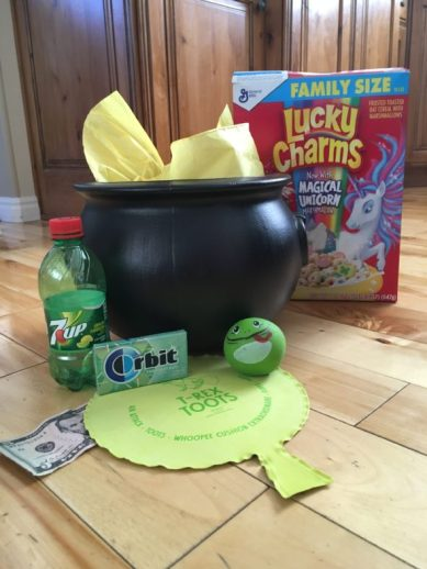 Pot of Gold with Lucky Charms, 7up, dollar bill, whoopee cushion, gum, splat ball