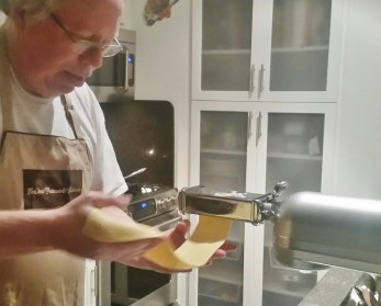 Receiving Newly Flattened Pasta Sheet From the Roller