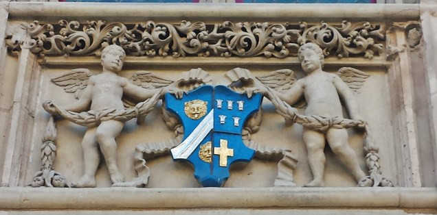 Cherubs Holding Crest Looking-Non-plussed Again