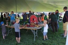 Farmers have the best toys - kids playing with tractors at the 2016 Breakfast
