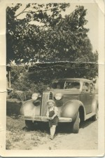 Lawrence Junion's nephew Eben Koss, in front of Lawrence's 1936 Pontiac