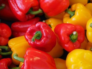 Several red and yellow peppers.