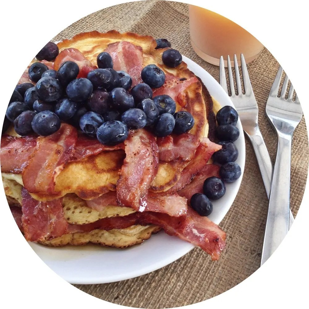 American pancakes with bacon and blueberries