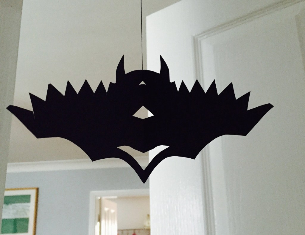 how to make halloween hanging bats, homemade halloween decorations for kids to make, halloween party ideas,