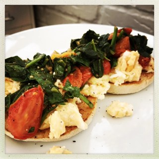 Heathy breakfast recipes - toasted muffins with creamy scrambled eggs spinach and tomatoes, vegetarian breakfast recipes.