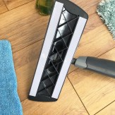 Close up of the underside of the ADDIS spray mop showing the velcro strips which hold the removable washable fleece head