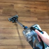 VAX Blade 32V cordless vacuum being used to clean laminate flooring