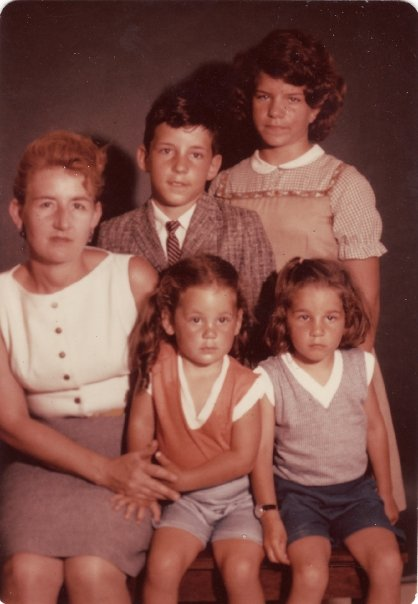 Family Pouting Contest, 1967.  My brother lost.  i earned bonus points for sweating profusely.  That's me in the orange...