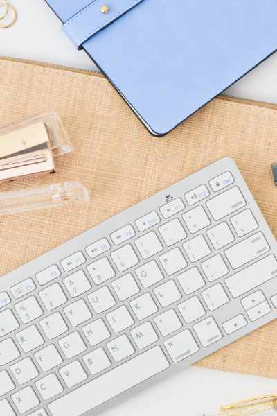 Picture of keyboard, stapler and some office supplies.
